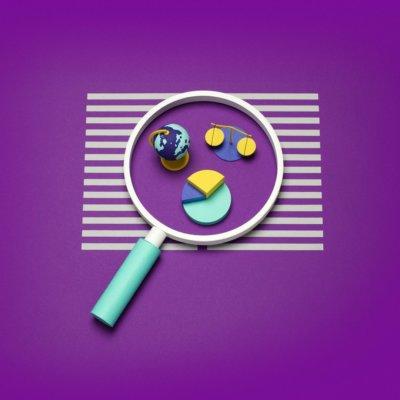 An illustration of a magnifying glass examining diagrams.