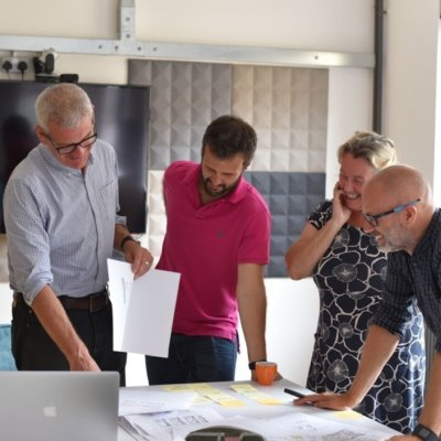 A group of people reviewing designs