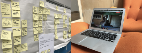 Post-it notes on a wall, and a laptop computer.