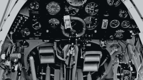 The many controls in the cockpit of a World War Two figher plane.