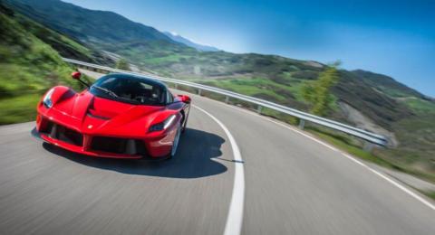 A Ferrari driving through the mountains