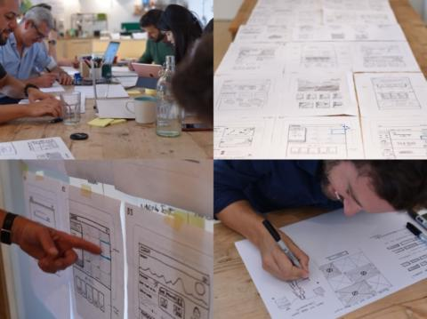 A group of people sketching wireframes