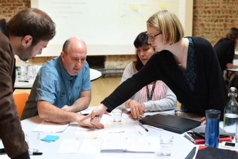 A group of people running a form design workshop