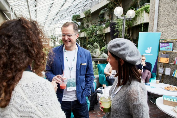 A man and two women at Leading design London in the Barbican conservatory