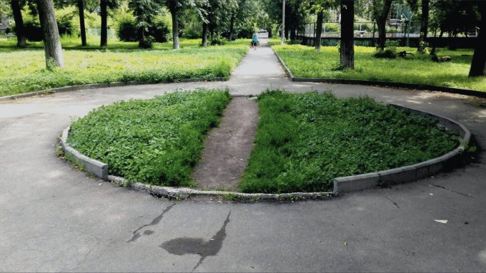 A green area with a pathway tramped across it.