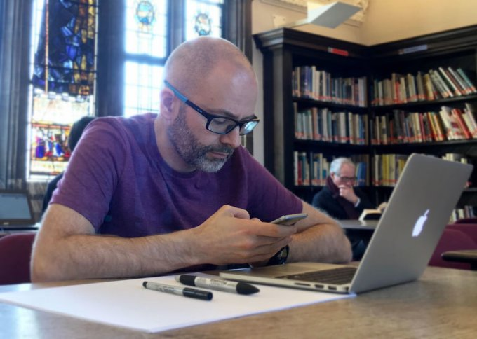 A man designing interfaces in Sketch in Suffolk library
