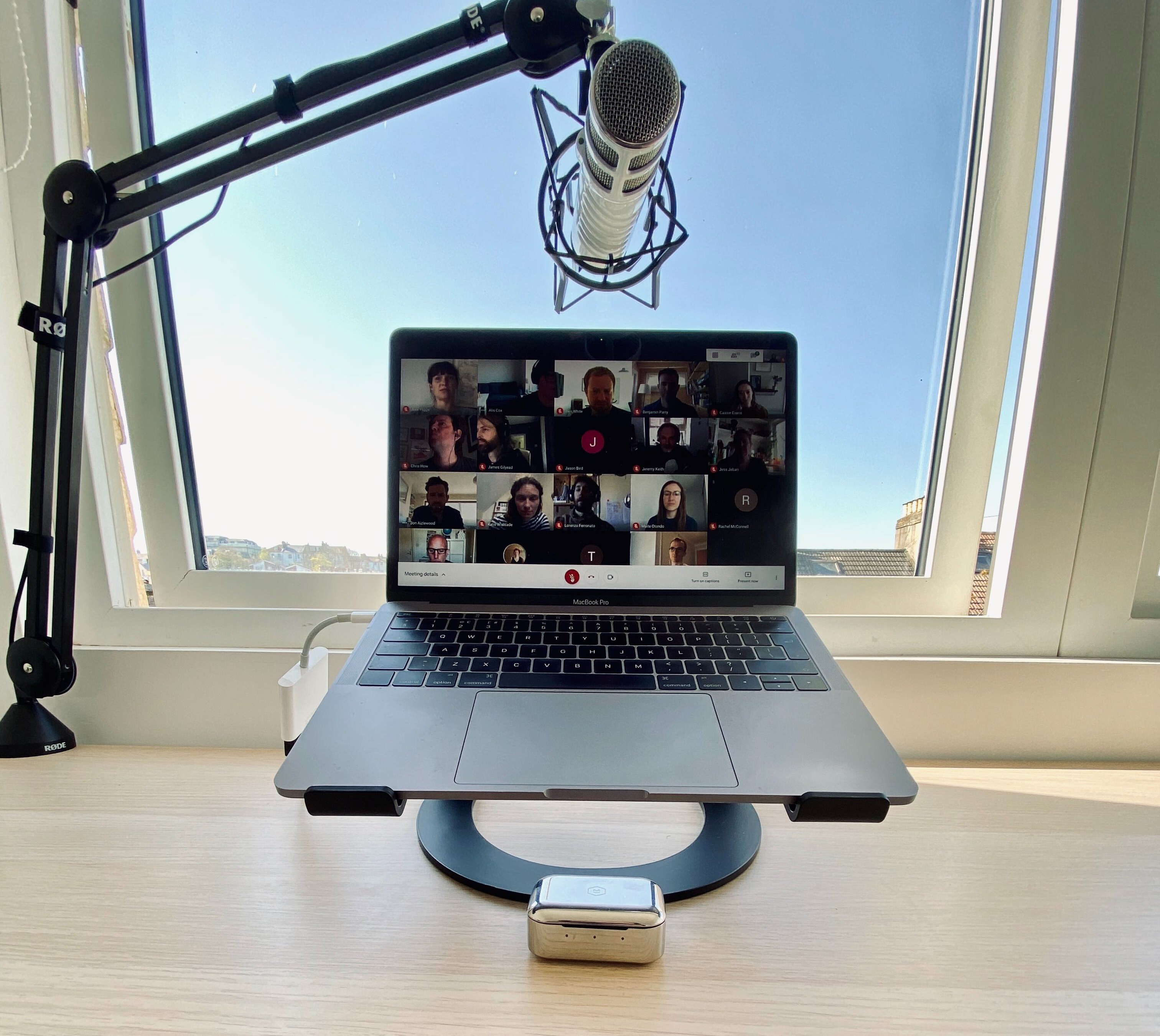 Laptop with a zoom call and microphone