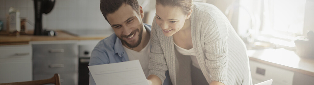 couple looking at document together