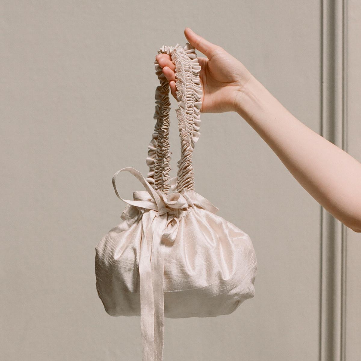 Smocked putty silk bag by Cawley Studio