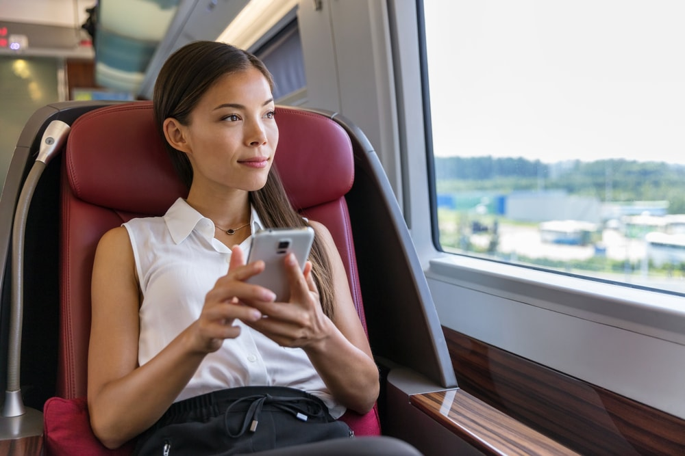 woman looking at window leonardo express