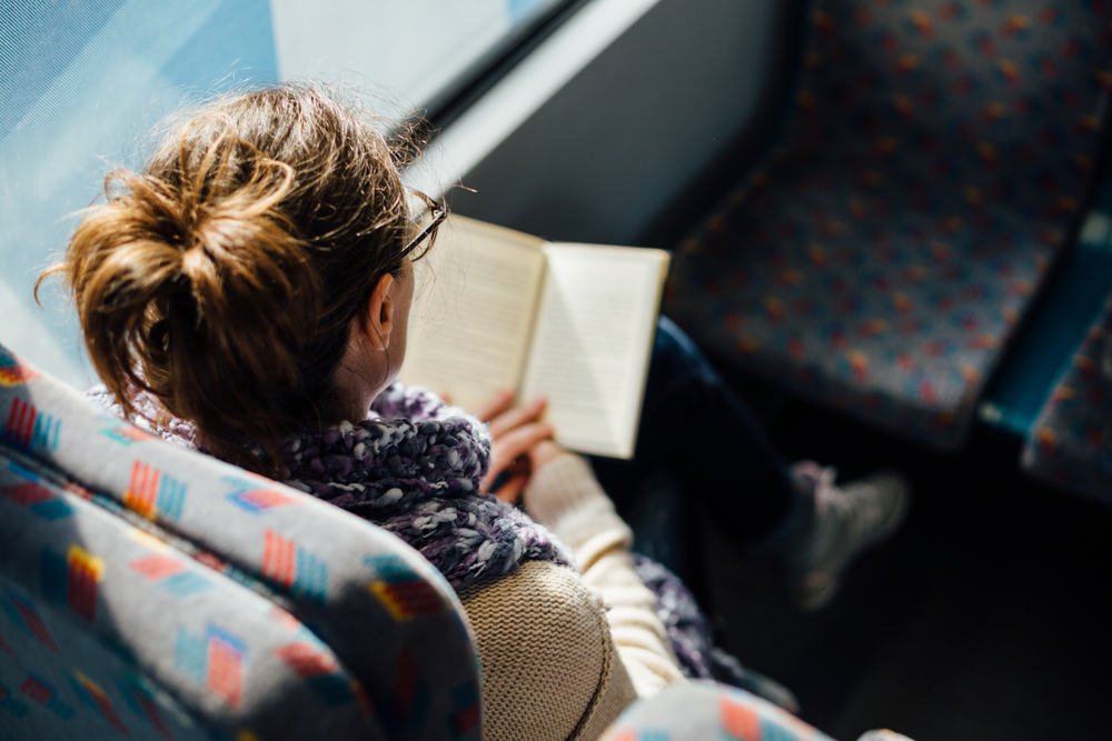 girl reading on train