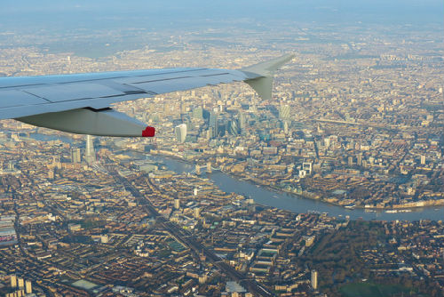 Plane flying over London City