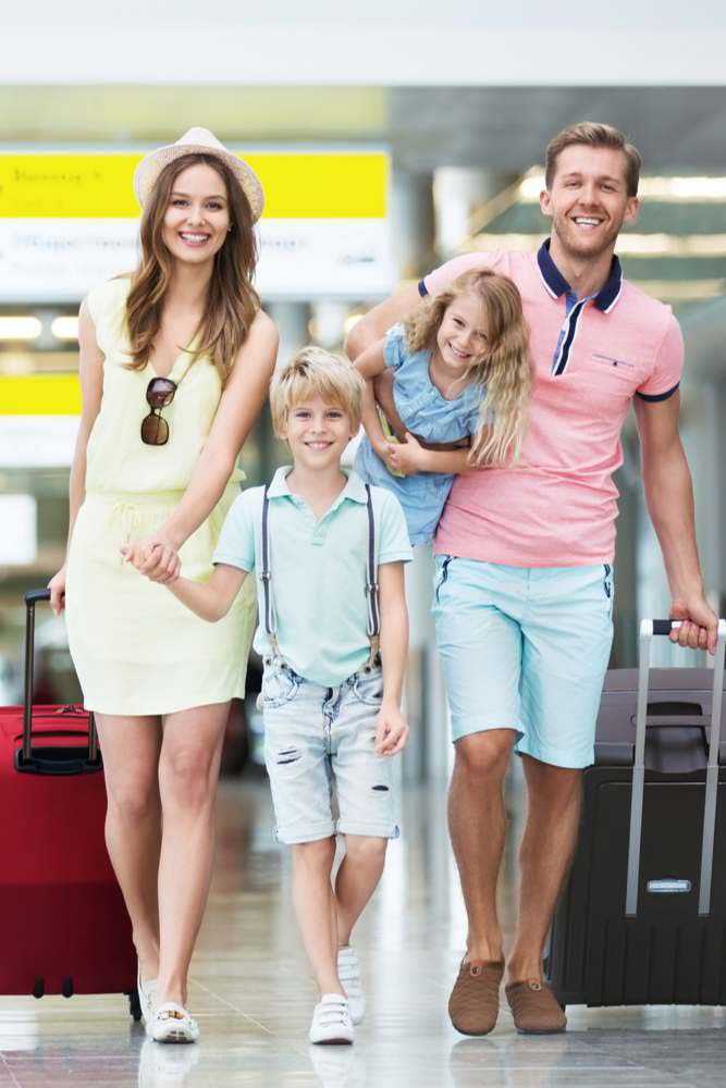 Family at airport with luggage