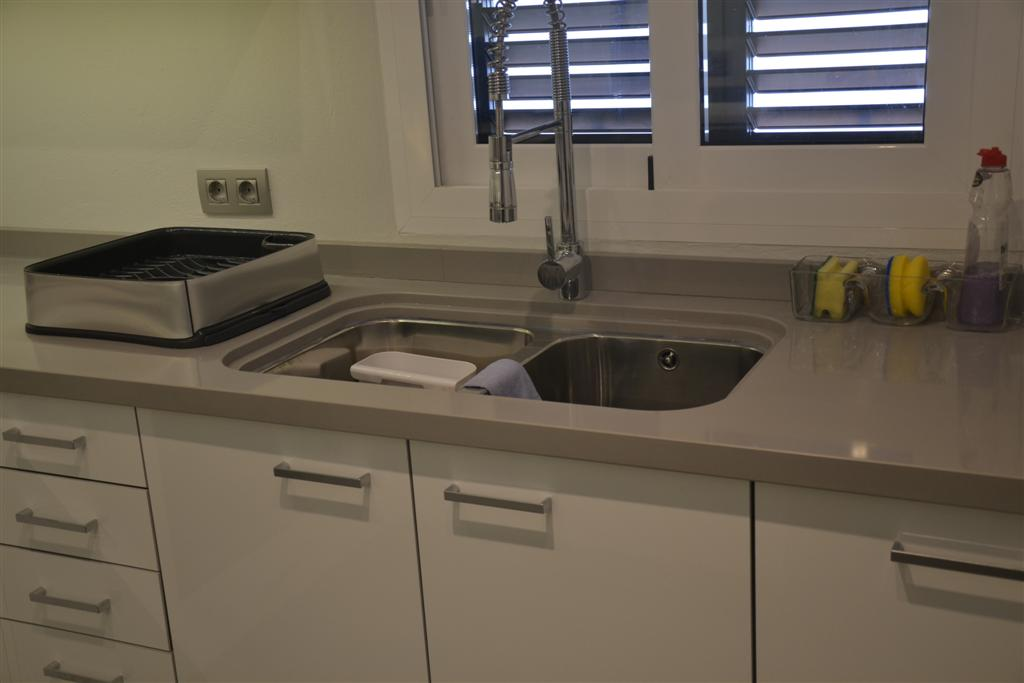 New kitchen in Glossy White and stainless handles