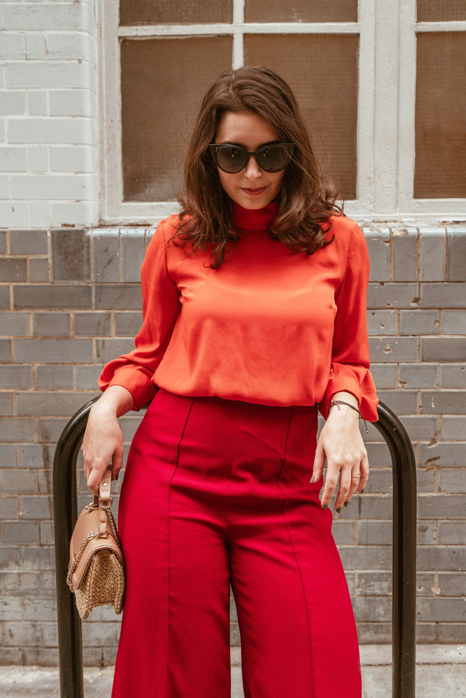 Marisa Oliveira from Arara Pintada wears red culottes with Orange Silk Blouse