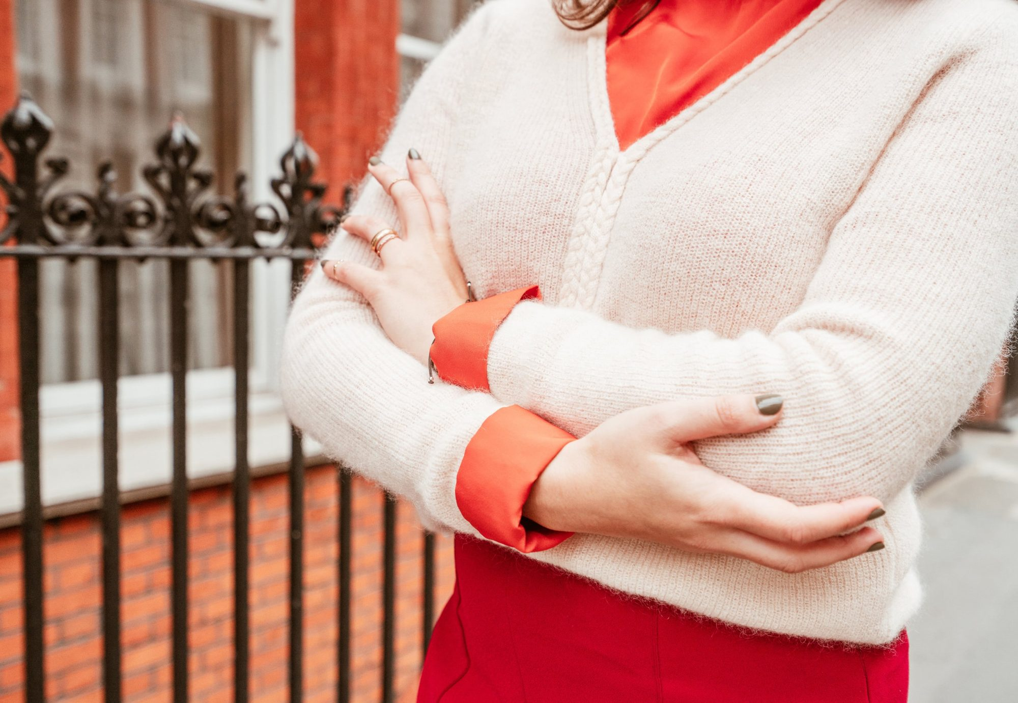 Details of Sézane Sienna Knitwear layered over a shirt