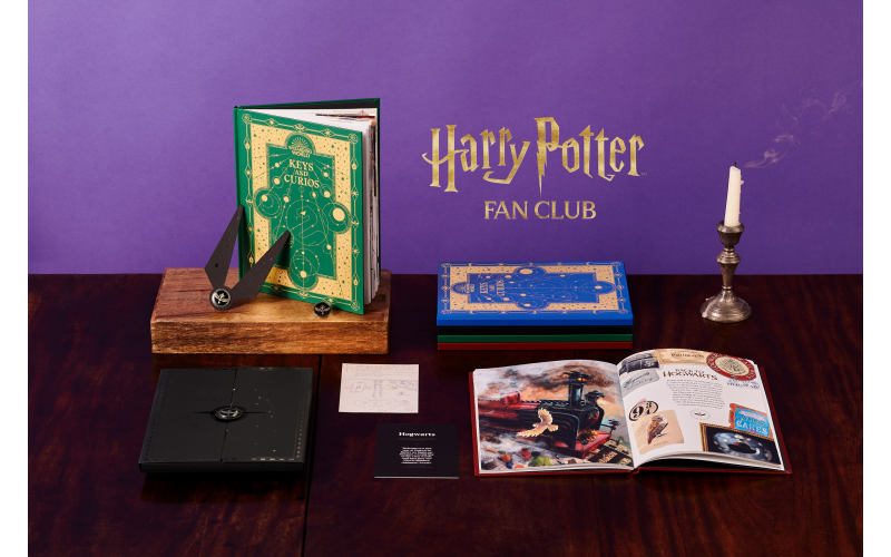 A one-year membership to Harry Potter Fan Club Gold and 4 First Edition Hogwarts House Pin Sets