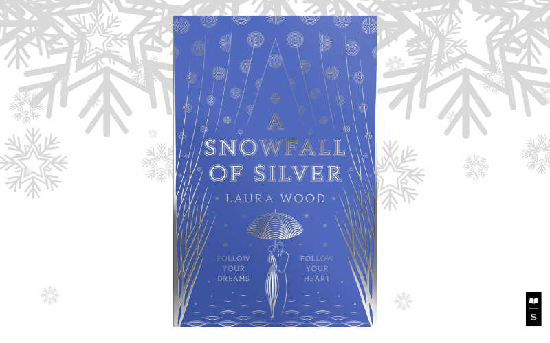 A copy of A Snowfall of Silver by Laura Wood, the must-read romance for winter.