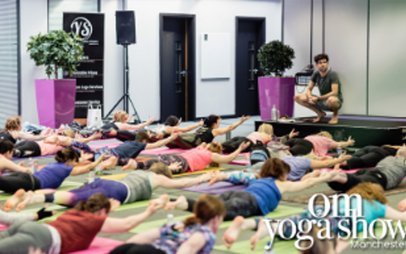A pair of weekend passes to the OM Yoga Show Manchester