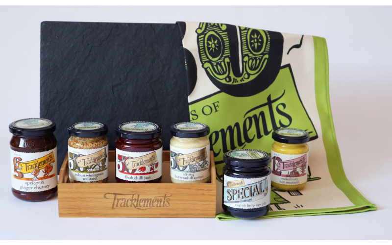 WIN A Tracklements wooden condiment caddy, engraved artisan slate cheeseboard and tea towel