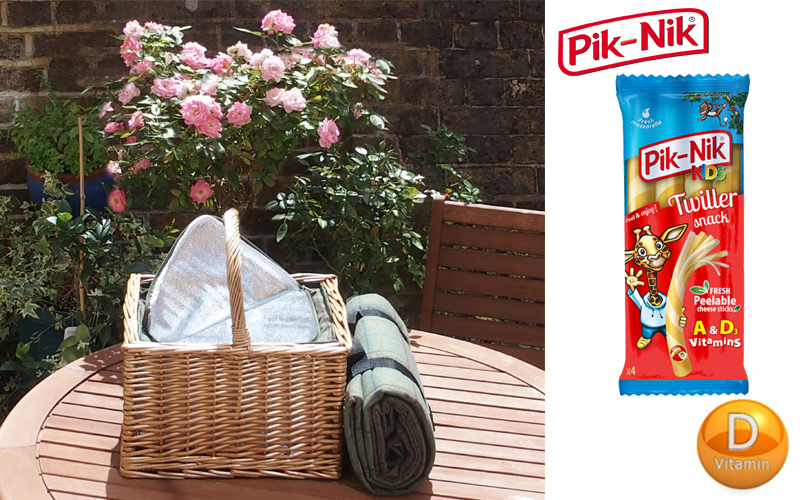 Picnic set including wicker hamper with a built in cool bag, rug and a selection of cheeses