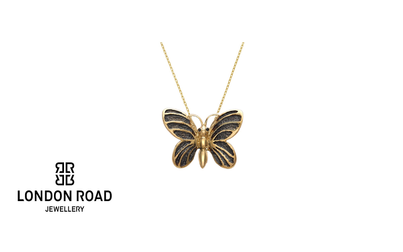 Win a Gold and Black Diamond Butterfly Pendant