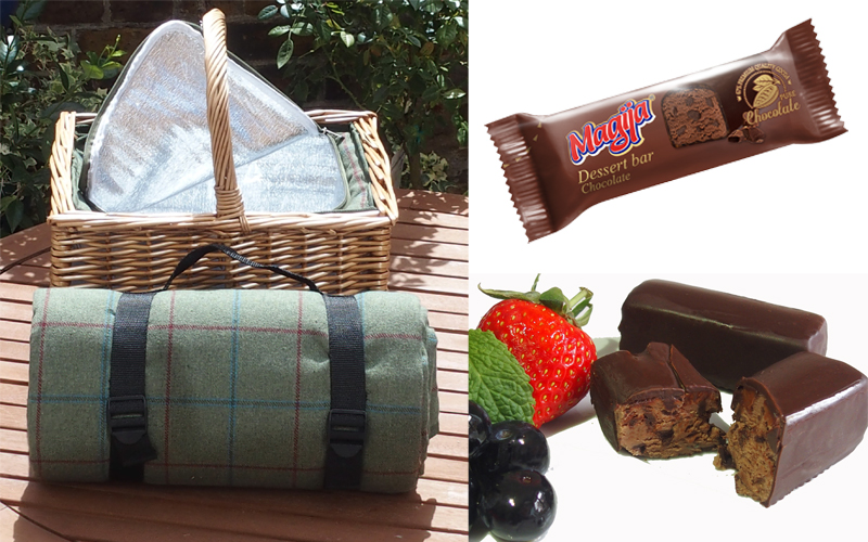 Picnic set containing a hamper with a built in cool bag, matching rug and a selection of cheeses including Magija