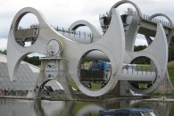 The Falkirk Wheel raises one boat while lowering the other one.
