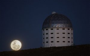 The supermoon rises behind the South African Large Telescope. Image Credit: Simon Fishley