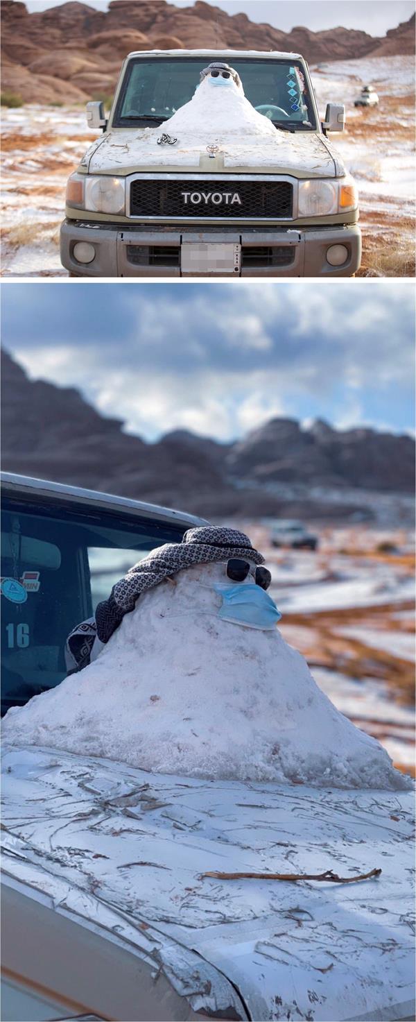 """مواطن يبني رجلاً من الثلج في تبوك ويلزمه بـ""""الكمامة"""""""