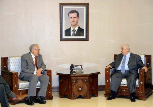 الموفد الدولي الى سوريا الاخضر الابراهيمي و وزير الخارجية السوري وليد المعلم