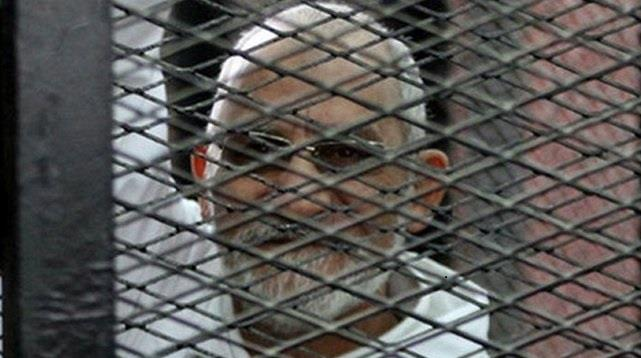 إحالة مرشد الإخوان و13 متهمًا آخرين للمفتي