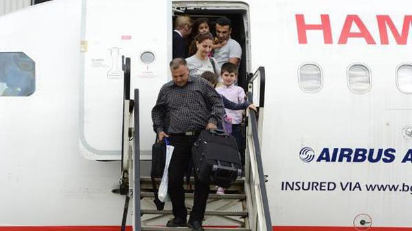 لاجئون سوريون يصلون المانيا