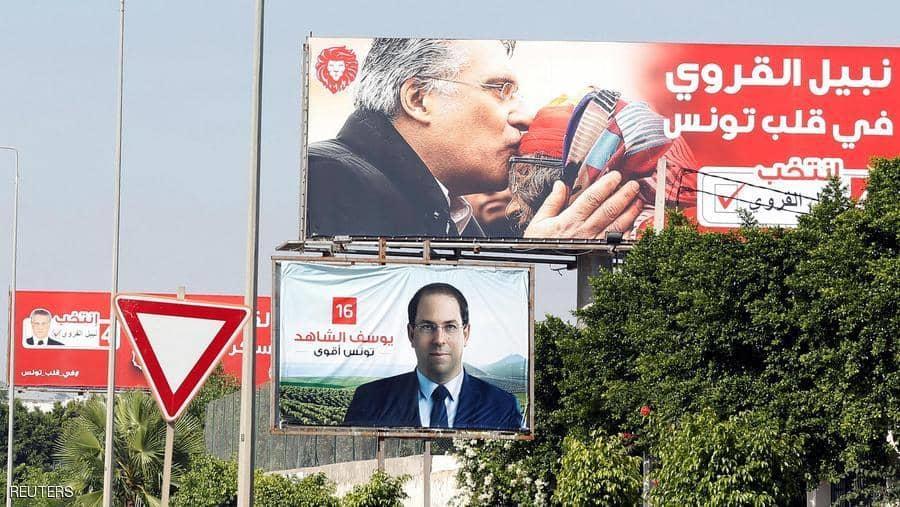 لافتات لمرشحين للانتخابات الرئاسية في العاصمة تونس.