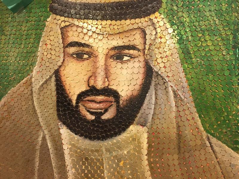 Designed the image of King Salman with 9 thousand.. A citizen collects 100 thousand coins from different countries of the world