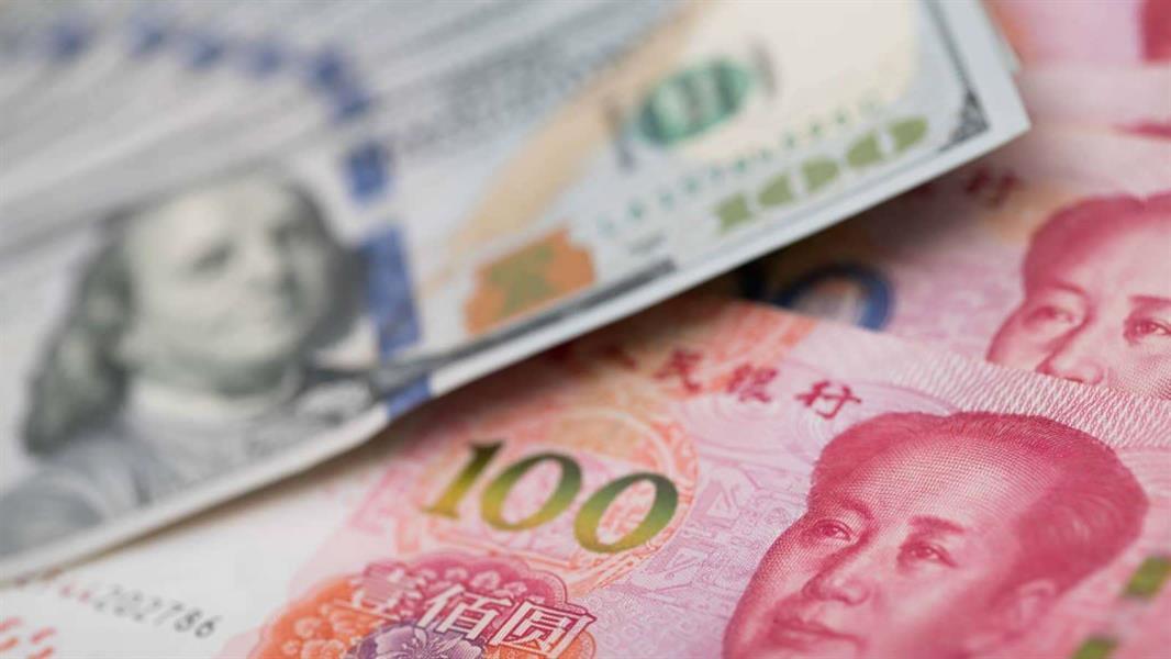 توقف خسائر الدولار واليوان يتراجع بعد تصريحات بايدن بشأن اتفاق التجارة