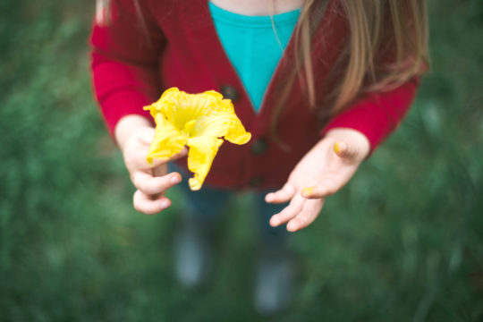 A child holding a lily
