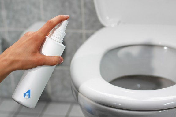 Using antibacterial spray in the bathroom │ Antibacterial products for house cleaning