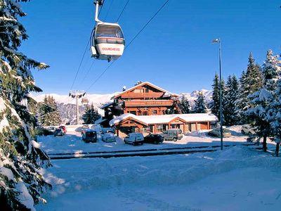 Hotel New Solarium: BUITENKANT HOTEL LE NEW SOLARIUM COURCHEVEL 1850 WINTERSPORT FRANKRIJK SKI SNOWBOARD RAQUETTES SCHNEESCHUHLAUFEN LANGLAUFEN WANDELEN INTERLODGE