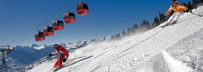 Skicircus Saalbach-Hinterglemm: CABINE EN SKIERS SAALBACH HINTERGLEMM OOSTENRIJK WINTERSPORT SKI SNOWBOARD RAQUETTE SCHNEESCHUHLAUFEN LANGLAUFEN WANDELEN INTERLODGE