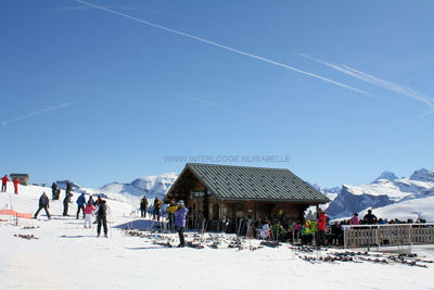 Le Grand Massif: BOVENOP TETE DE SAIX GRAND MASSIF LES CARROZ FRANKRIJK WINTERSPORT SKI SNOWBOARD RAQUETTE SCHNEESCHUHLAUFEN LANGLAUFEN WANDELEN INTERLODGE