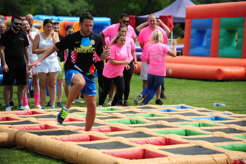 PMP raises over £25,000 for Unseen and Cancer Research UK at its family fun day