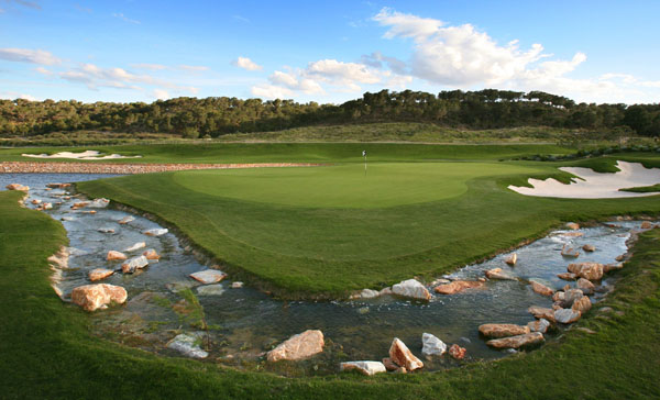 The brook almost encircles hole 14