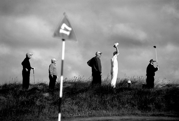 A player in the competition drives his 'blind' tee-shot at the par-4 second hole.