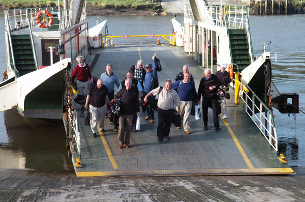 Golfers disembarking from the ferry at Waterford Castle golf course