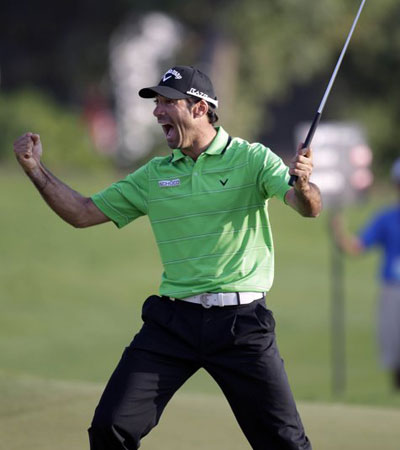 Quiros reacts to holing his winning eagle putt