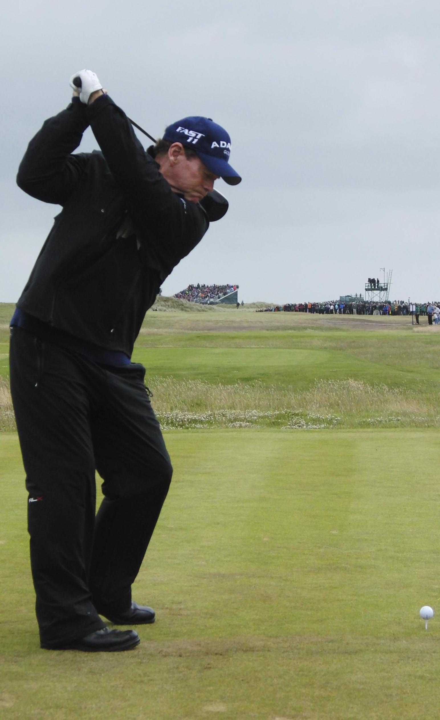 Watson in action at The Open with his raised left heel