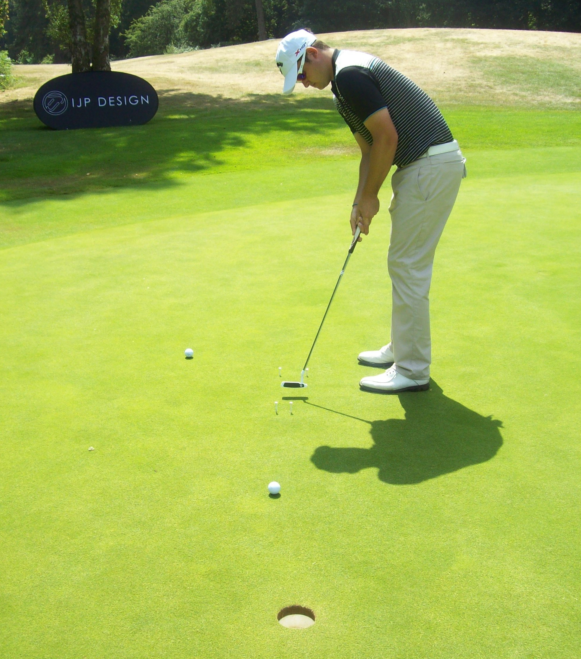 Boyd putts through his target and into the hole