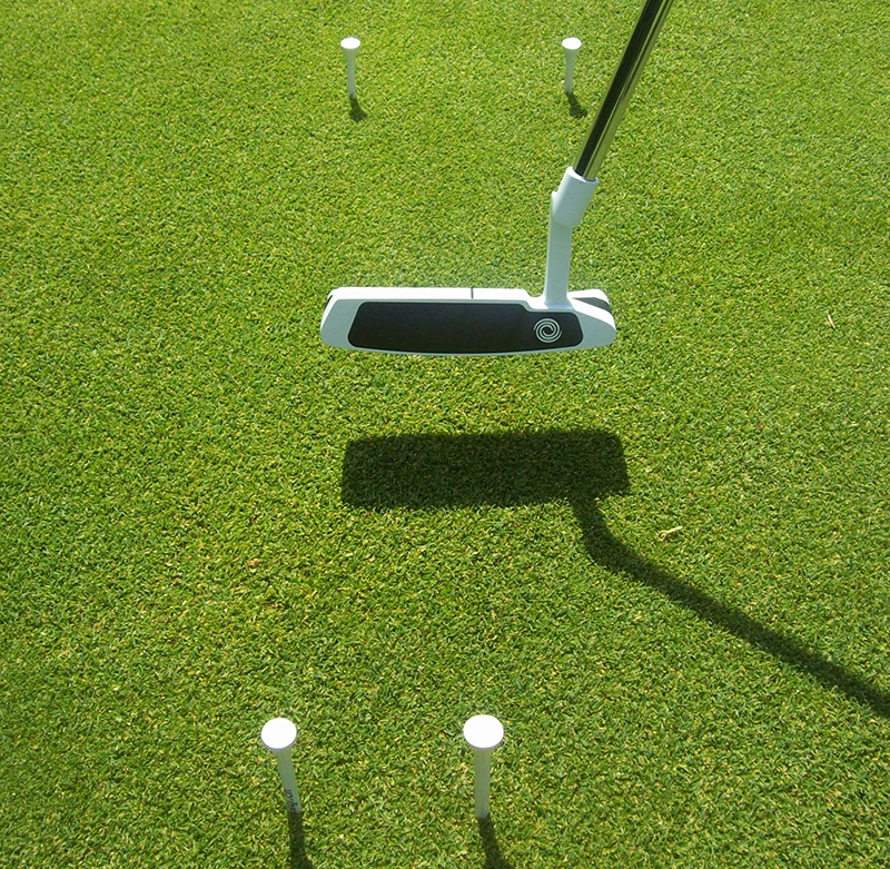 Then place another two tee pegs, a foot in front, a ball's width apart