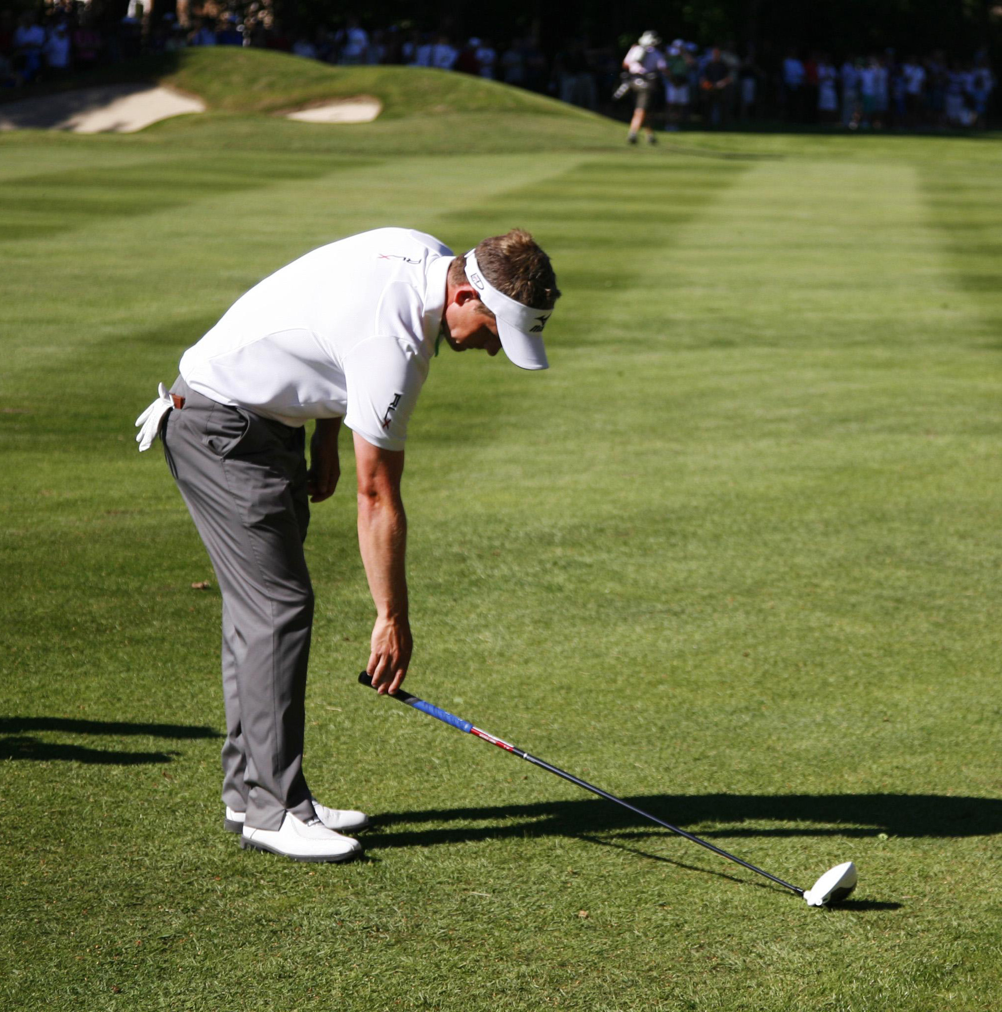 Luke Donald taking a two-club-length drop after going into a water hazard